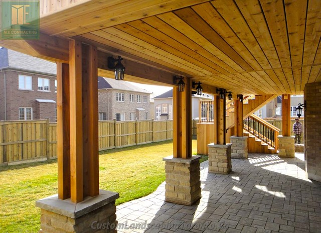 Cedar deck with walkout basement and pergola traditional for Walkout basement patio ideas