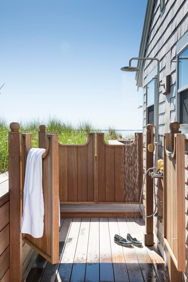 Example of a beach style outdoor shower deck design in Boston with no cover