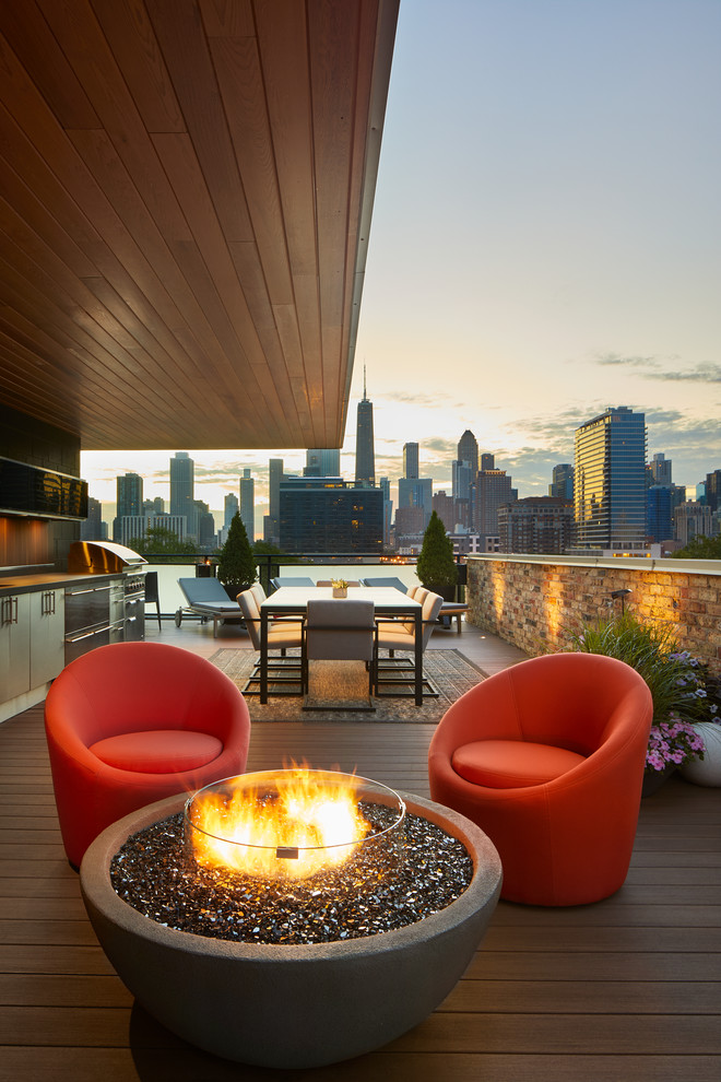Mid-sized trendy rooftop rooftop deck photo in Chicago with a fire pit and an awning