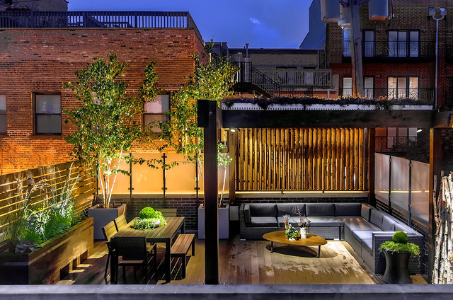 Example of a trendy rooftop deck design in chicago with a pergola