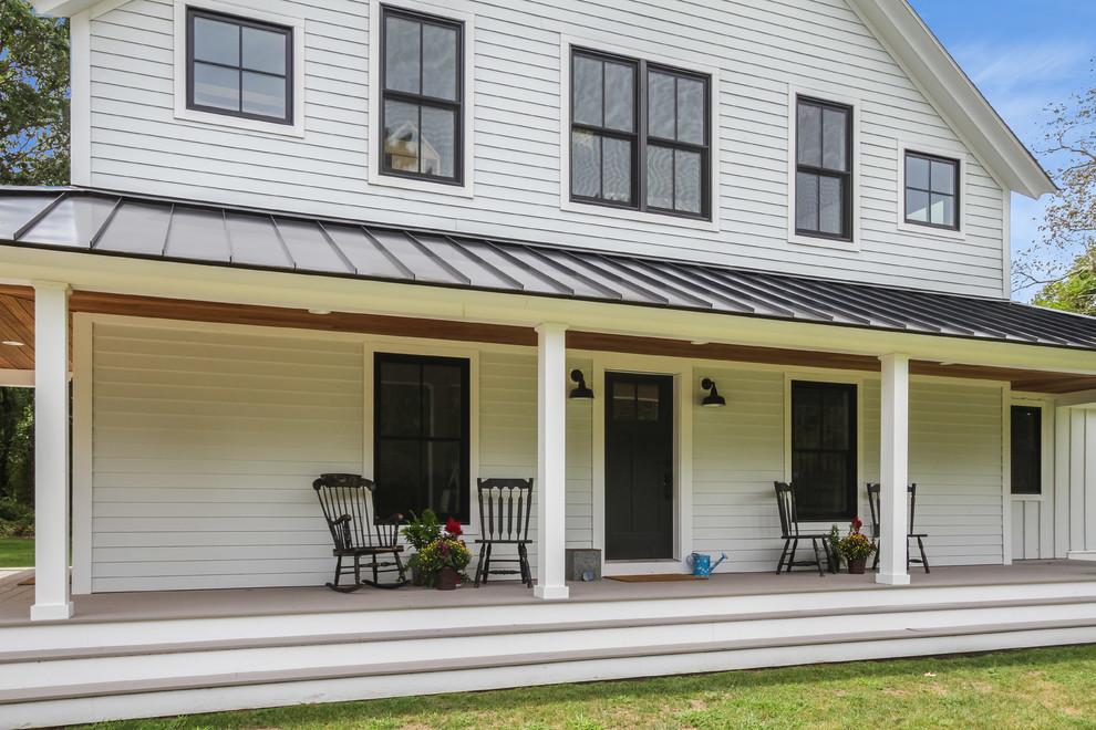 Coastal Modern Farmhouse With Black Metal Roof And Wraparound Porch Farmhouse Deck Bridgeport By Connecticut Valley Homes And Ri Modular Homes