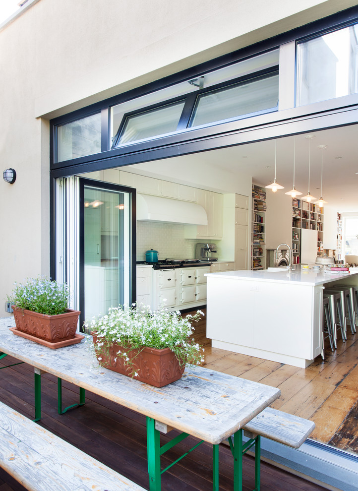 Deck container garden - mid-sized contemporary backyard deck container garden idea in New York with no cover