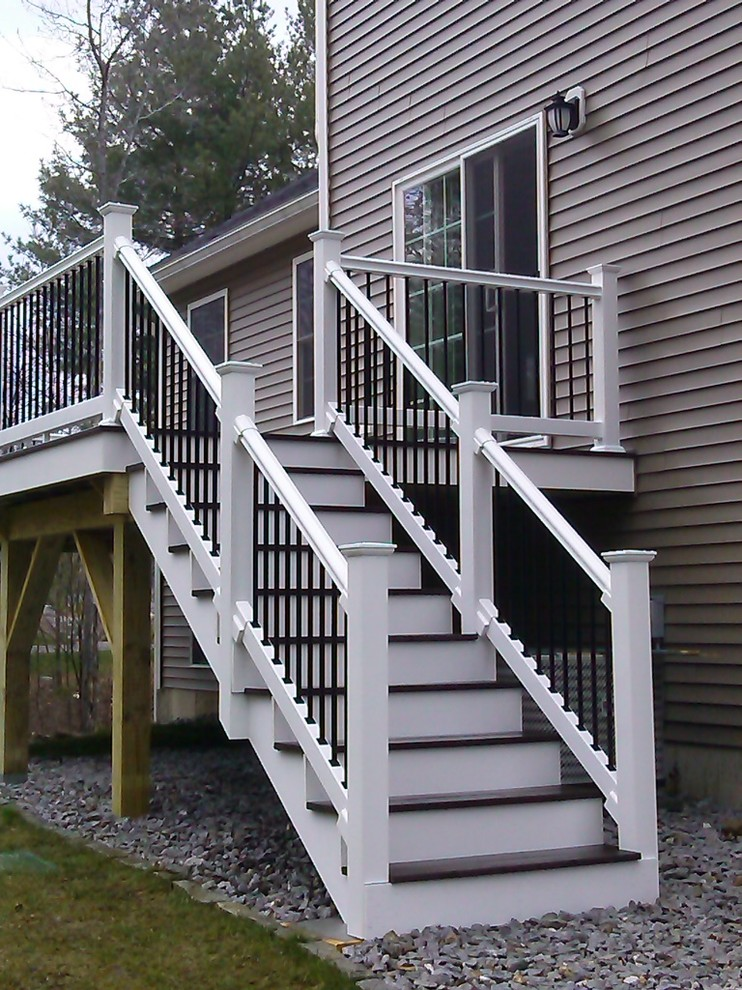 Composite Deck With Black Metal Balusters On White Railings Is Stunning Contemporary Deck Manchester By Jws Custom Decks Llc