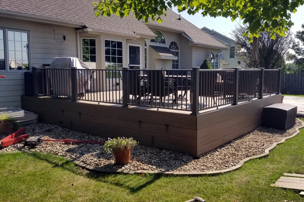 Example of a large backyard deck skirting design in Other with no cover