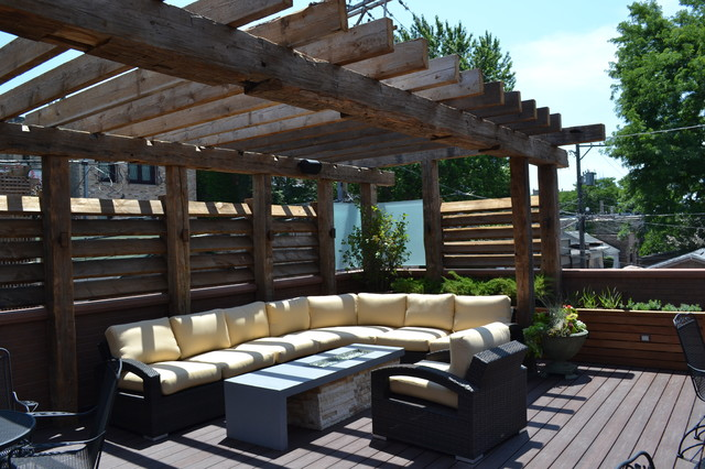 Contemporary outdoor space with reclaimed timber pergola for Contemporary garden decking