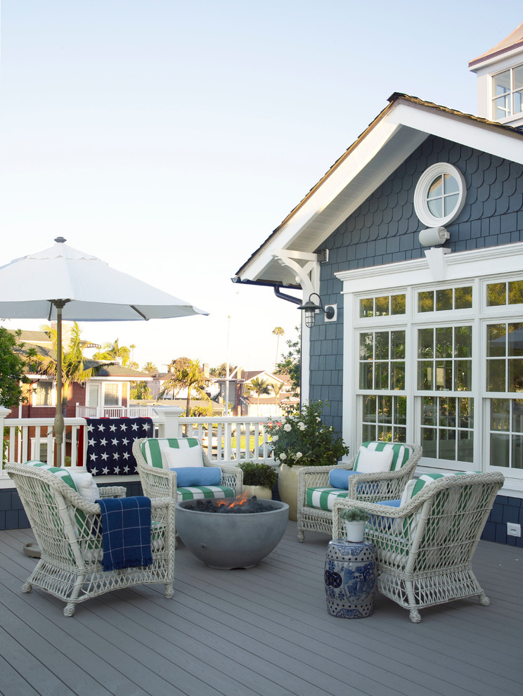 Inspiration for a small coastal deck remodel in San Diego with a fire pit