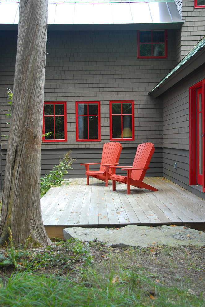 Small mountain style backyard deck photo in Burlington with no cover