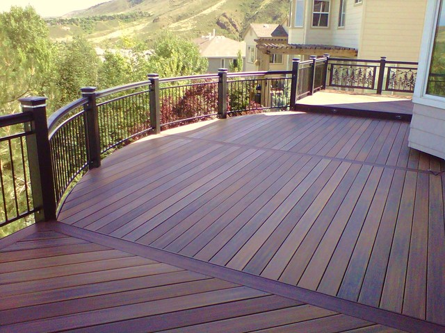 Curved Deck With Custom Iron Railings And Led Lighting