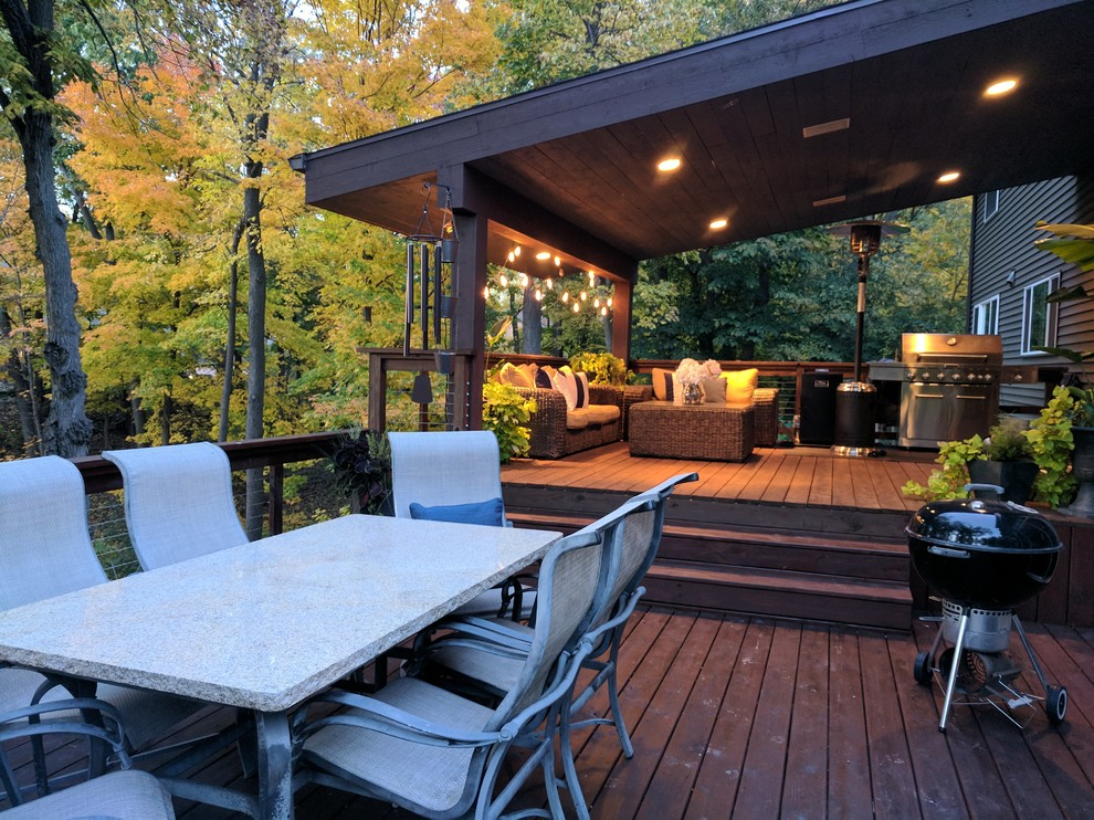 Mid-sized mountain style backyard deck photo in Other with no cover