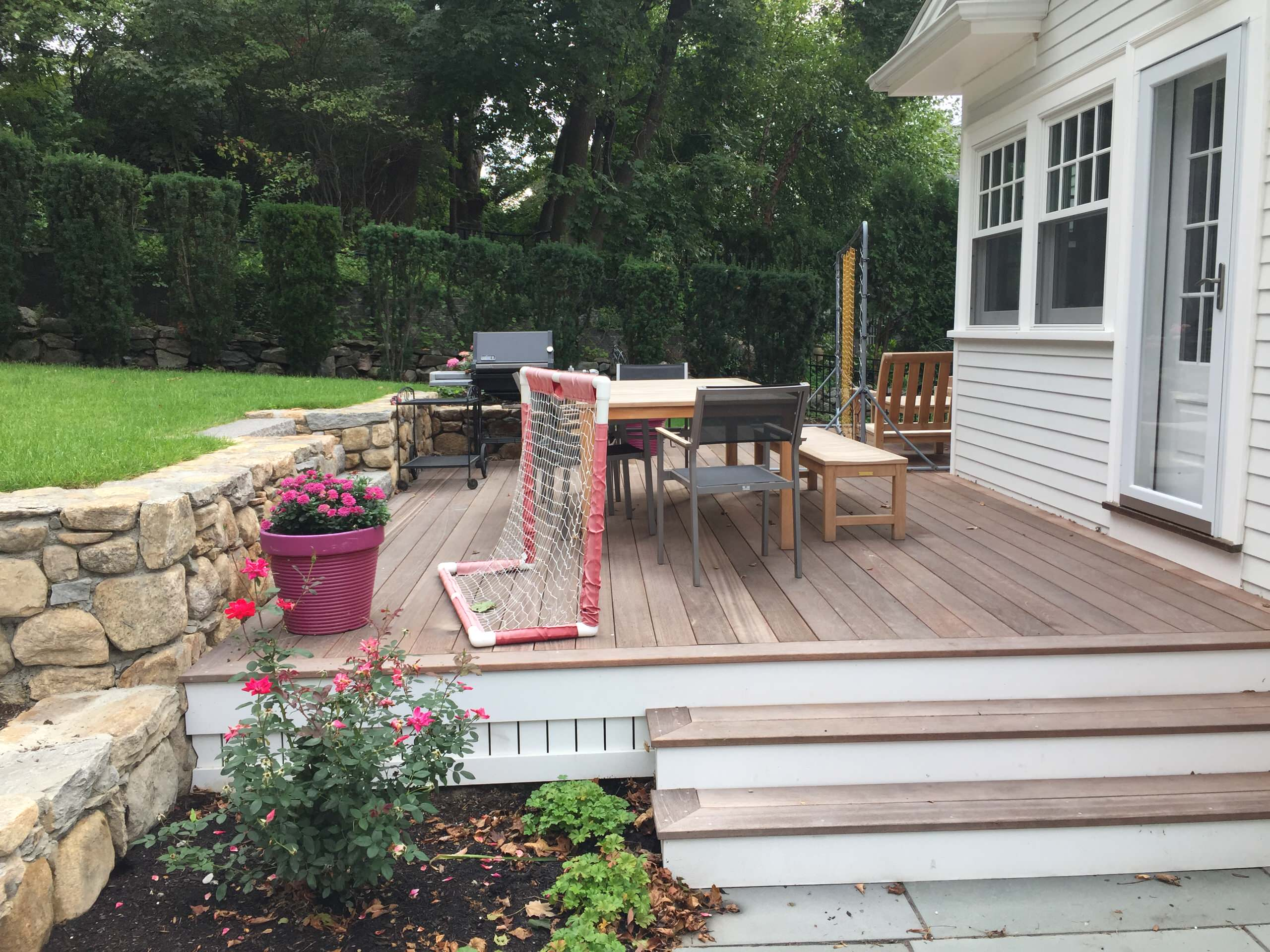 deck connects kitchen to upper lawn