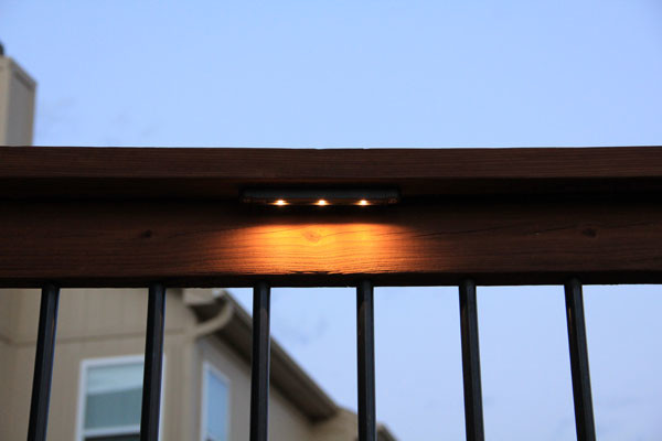 Deck lighting using low under railing LED lights traditional-deck