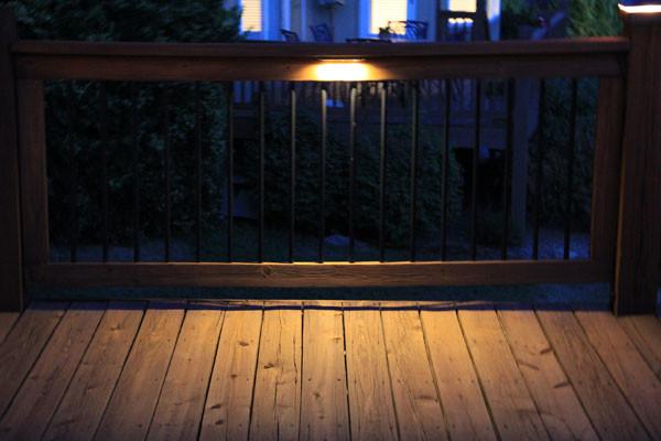 Deck lighting using low under railing LED lights traditional-deck
