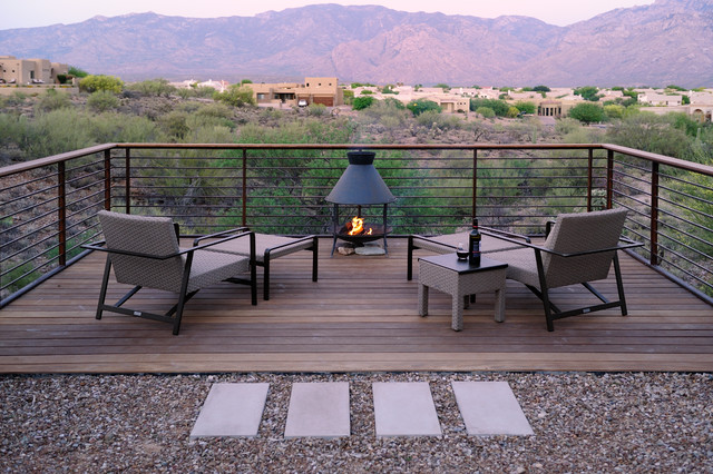 Example Of A Trendy Deck Design In Phoenix With A Fire Pit
