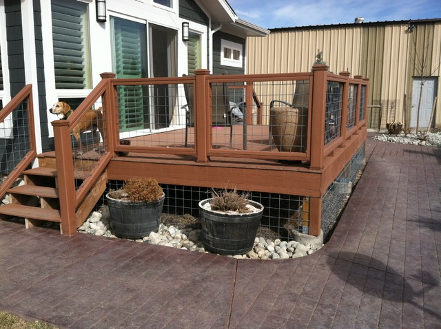 Decks and patios rustic deck denver by dwyer for Rustic porches and decks