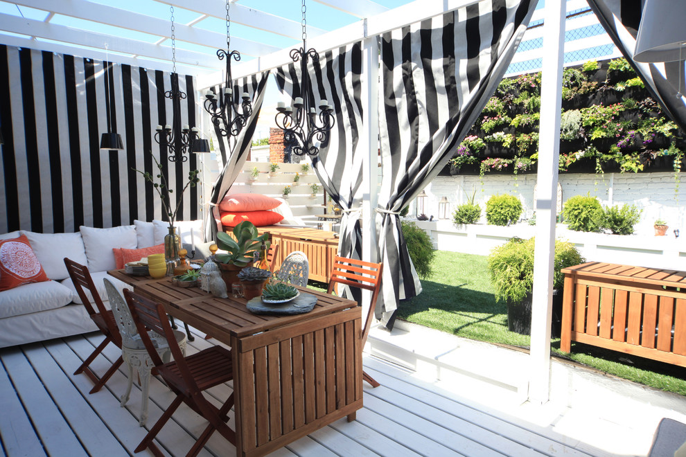 Example of an eclectic deck container garden design in New York