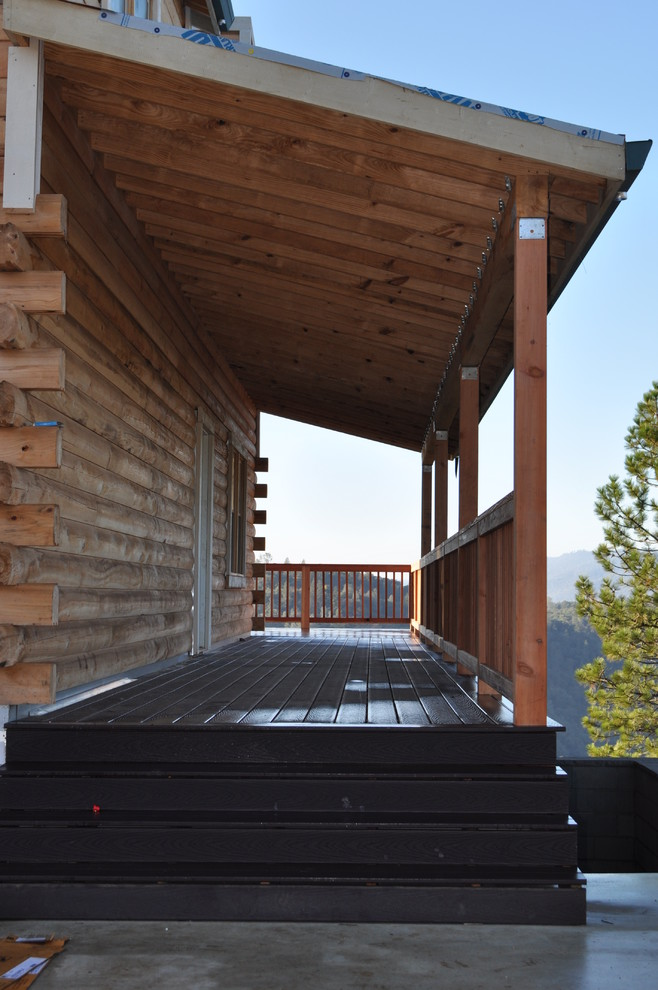 Deck - large craftsman deck idea in Sacramento with a roof extension