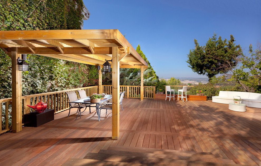 Deck - traditional deck idea in Other with a pergola