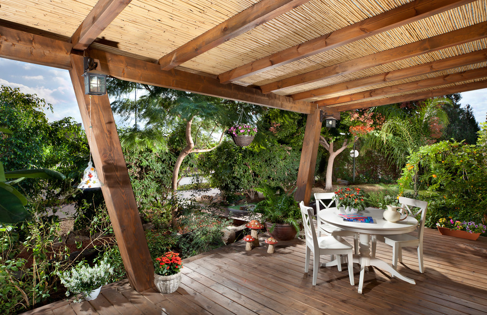 Inspiration for a tropical deck remodel in Other