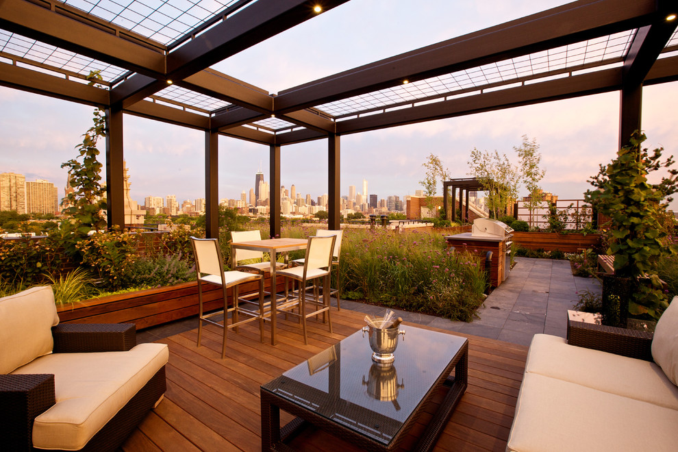 Example of a large trendy rooftop rooftop deck design in Chicago with a pergola