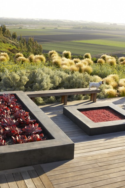 Inspiration for a large contemporary backyard deck remodel in San Luis Obispo with a fire pit