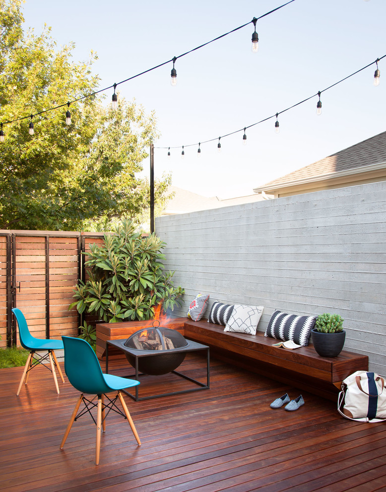 Deck - small contemporary backyard deck idea in Austin with a fire pit and no cover