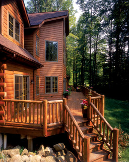 Flood wood care rustic log cabin rustic deck by for Log home decks