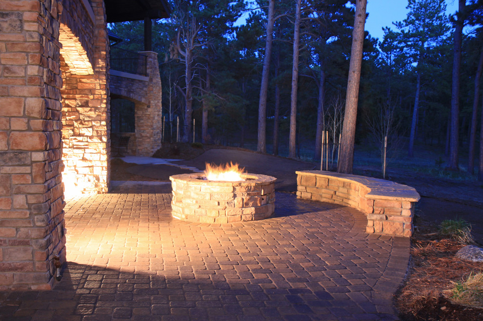 Example of a large classic backyard deck design in Denver with a fire pit and no cover