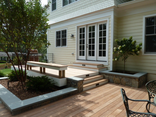 Geometric Wood Deck With Stone Retaining Walls
