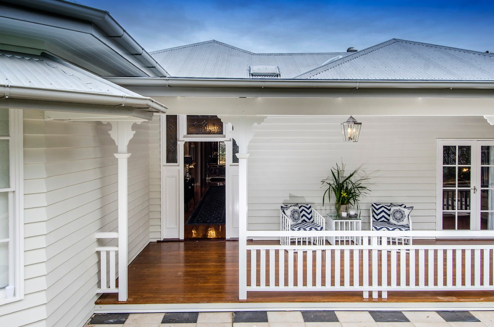 Mid-sized beach style deck photo in Brisbane with a roof extension