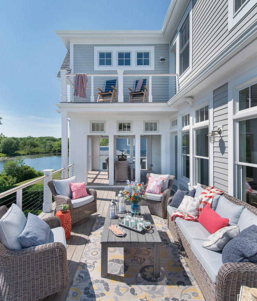 Mid-sized beach style backyard deck photo in Providence with no cover