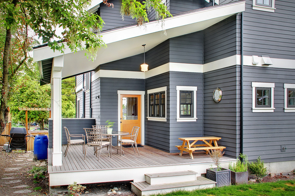 Mid-sized elegant backyard deck container garden photo in Seattle with a roof extension