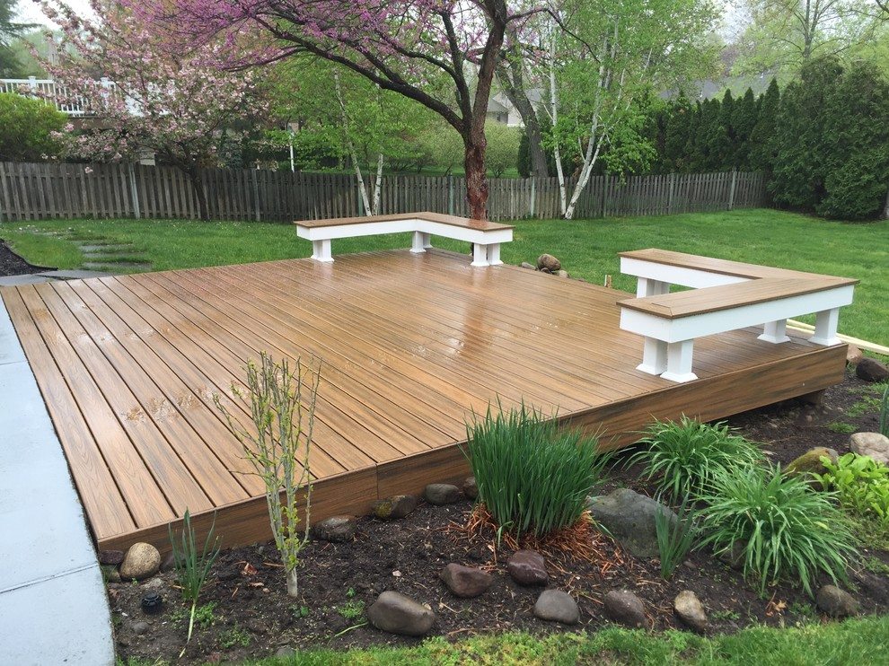 Deck - mid-sized modern backyard deck idea in New York with no cover