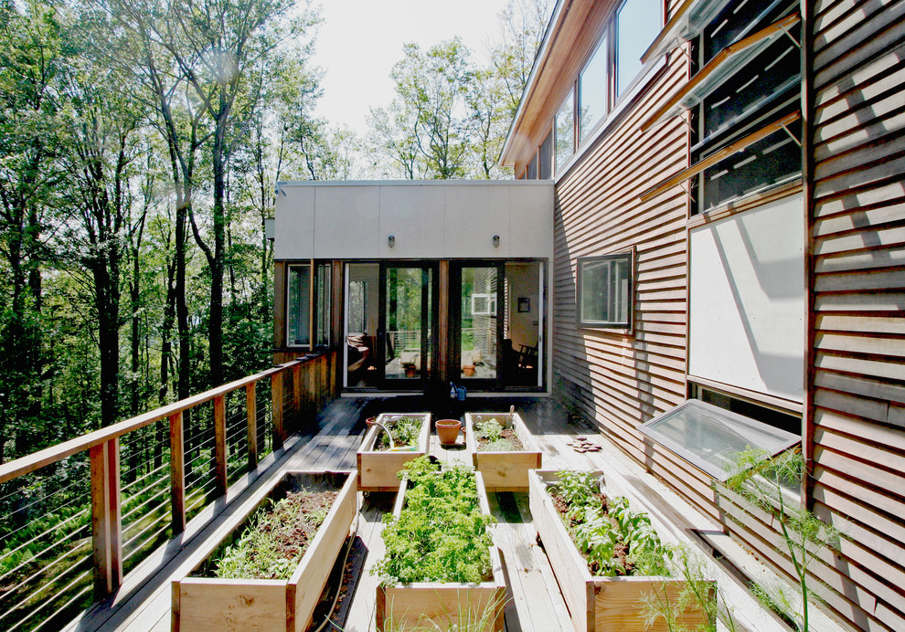Example of a trendy backyard deck design in New York