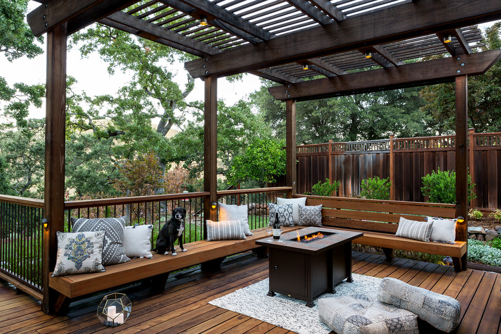 Example of a large classic backyard mixed material railing deck design in San Francisco with a fire pit and a pergola