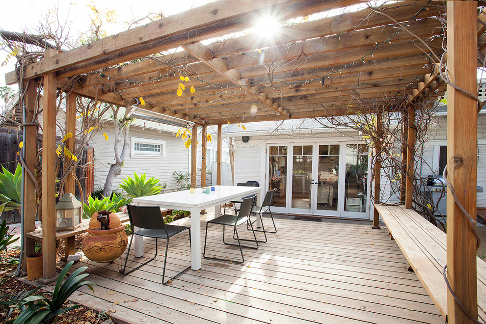 Large elegant backyard deck photo in Los Angeles with a pergola