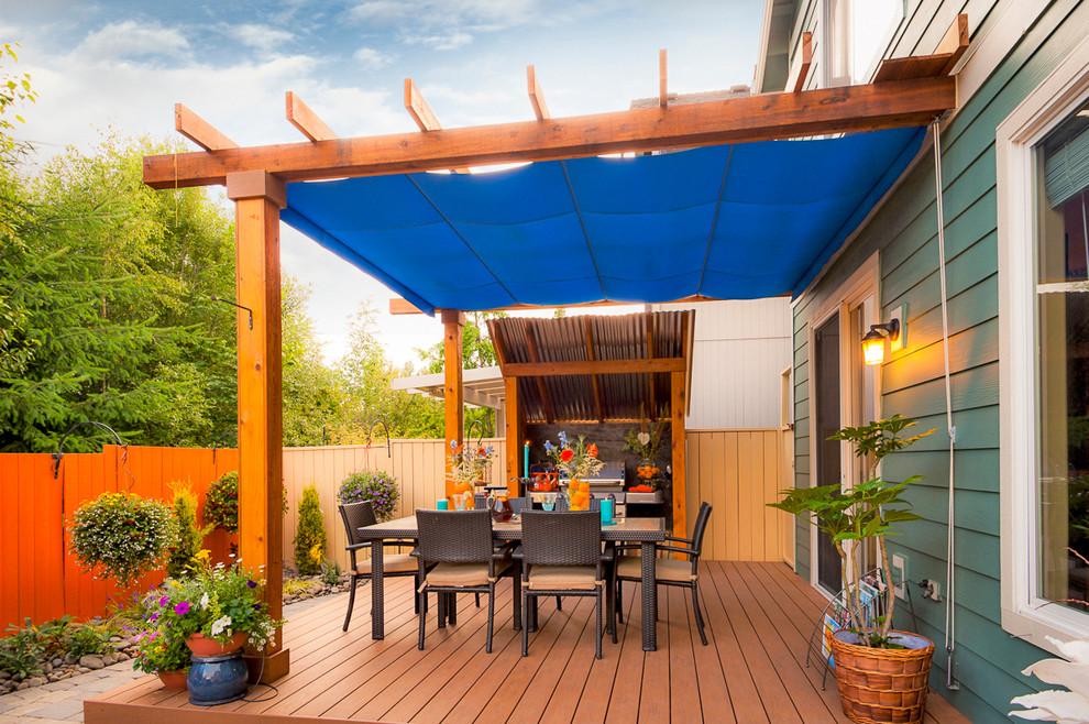 Transitional outdoor kitchen deck photo in Portland