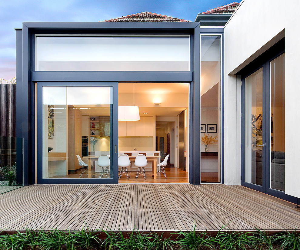 Example of a trendy backyard deck design in San Diego with no cover