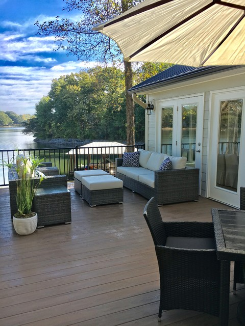 Inspiration for a mid-sized transitional backyard deck remodel in Charlotte with no cover