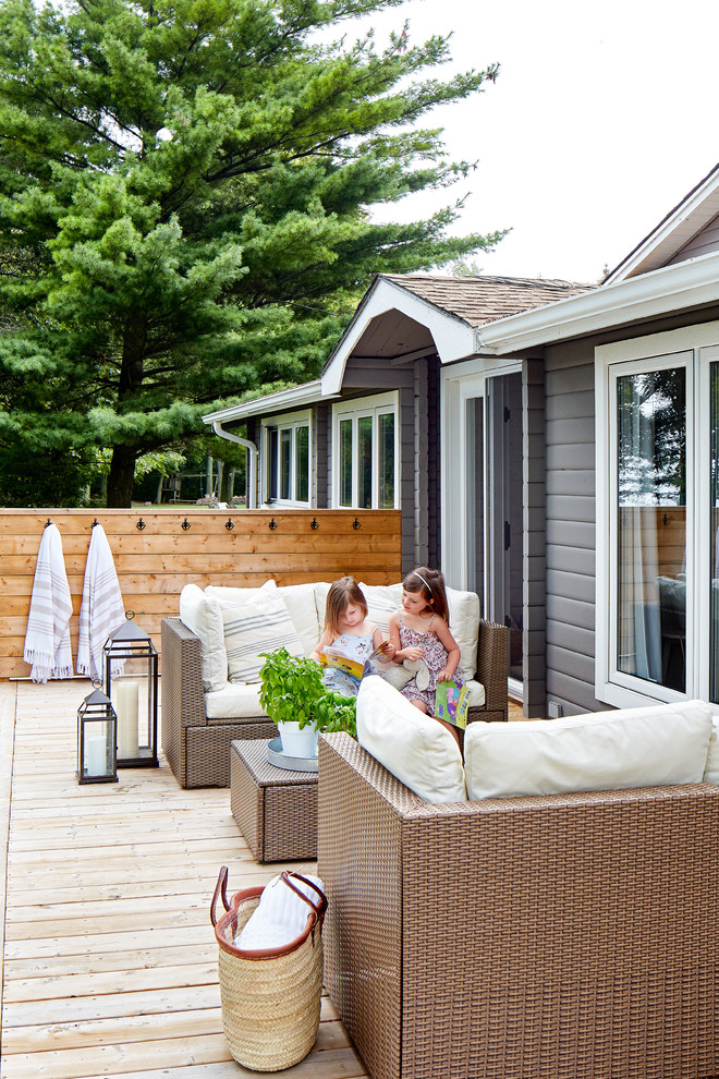 Inspiration for a mid-sized coastal backyard outdoor shower deck remodel in Toronto with no cover