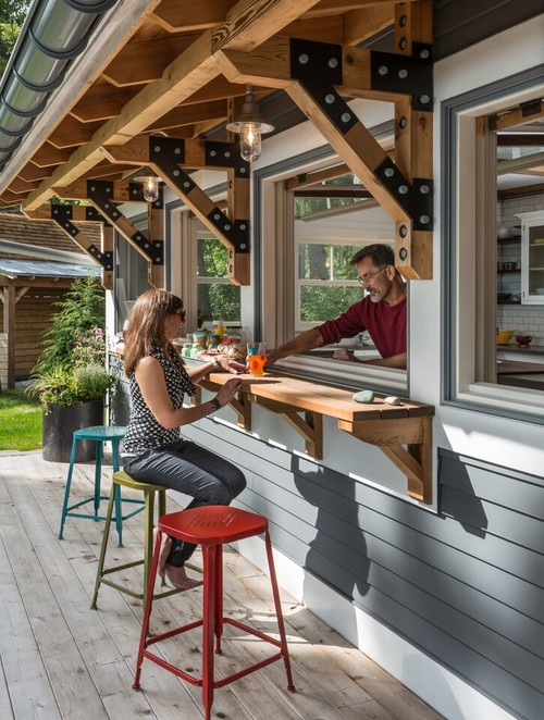This Wonderful Porch Transforms Into An Iced Tea Stand, Buffet And A Bar  Thanks To Four Swing Up Windows Along The Kitchen Wall.