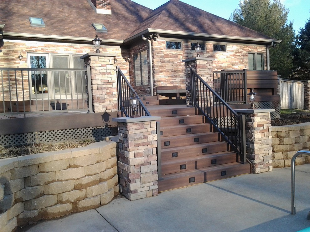 Example of a large arts and crafts backyard outdoor kitchen deck design in Indianapolis with no cover