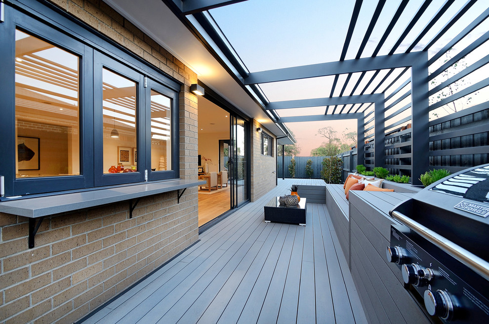Example of a large trendy side yard deck design in Melbourne with no cover