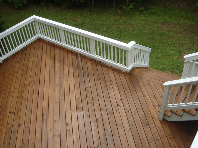 Large Wood Deck With White Picket Railing