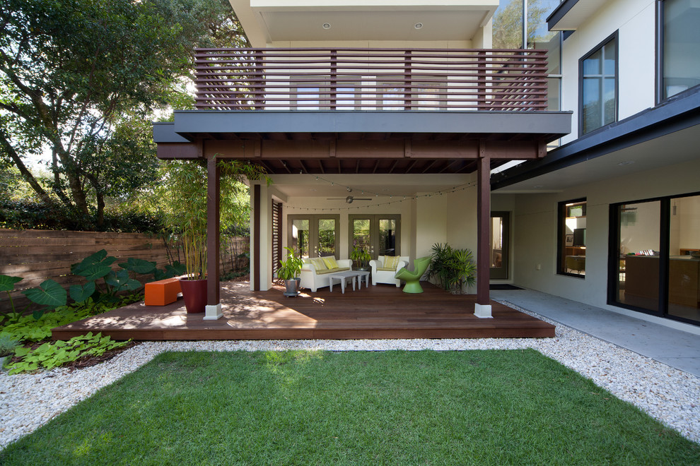 Inspiration for a contemporary deck remodel in Orlando with a roof extension