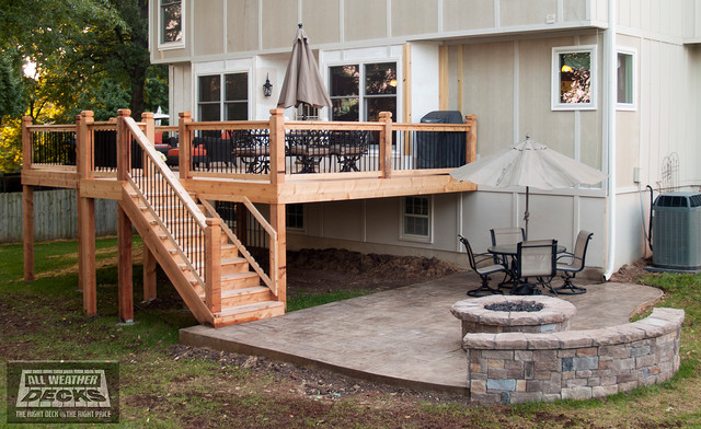 Leeder cedar deck in kansas city with stamped concrete patio and firepit traditional deck for Pictures of small patios and decks