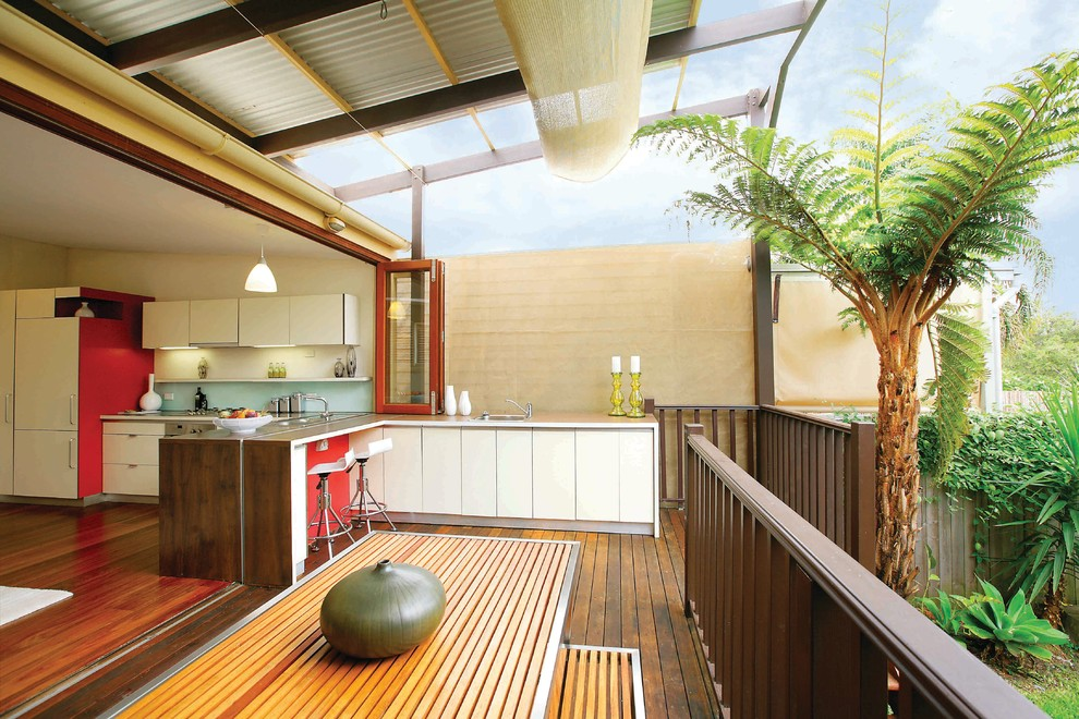Inspiration for a contemporary deck remodel in Sydney with a roof extension