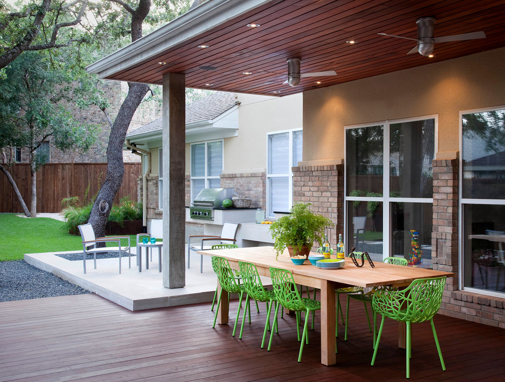 Inspiration for a mid-sized contemporary backyard outdoor kitchen deck remodel in Austin with a roof extension