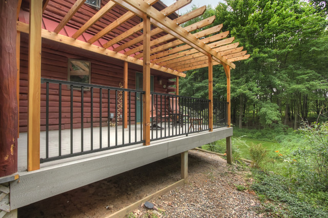 Log Cabin Deck With Pergola Rustic Deck Grand Rapids By Thompson Remodeling