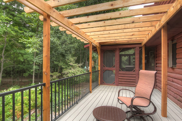 Log cabin deck with pergola rustic deck grand rapids for Log home decks