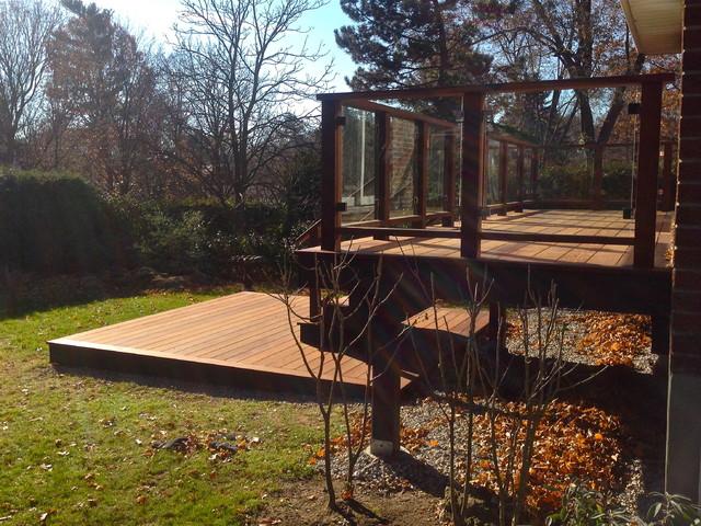 Deck - mid-sized modern backyard deck idea in Toronto